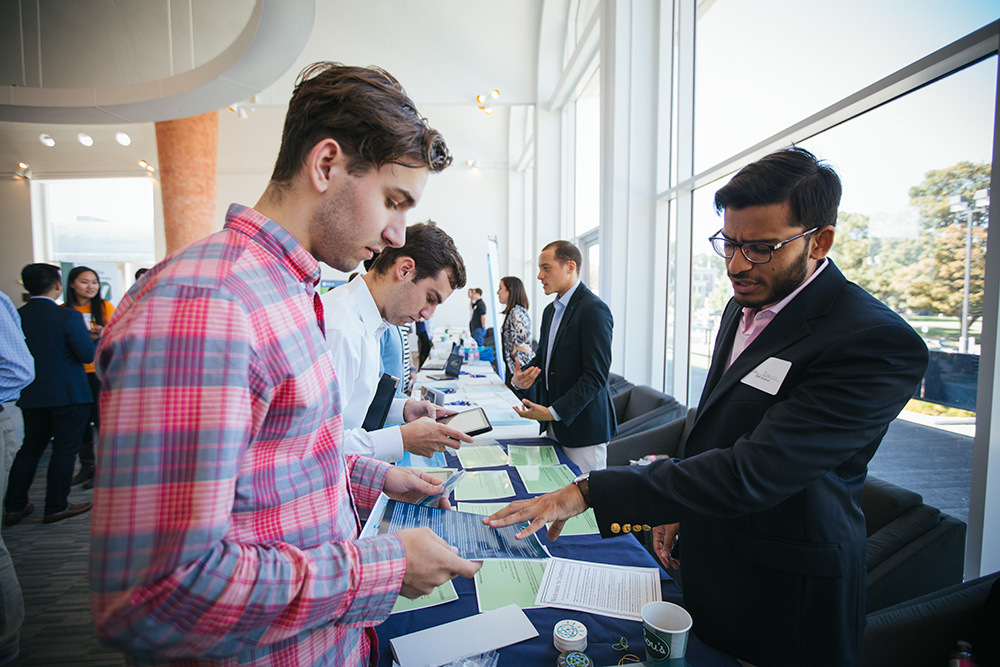 A student speaks with a recruiter at a hiring fair